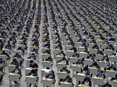 159,889 Wall Streeters are crowding auditoriums and classrooms to take a grueling 6-hour test. If they pass it could change their lives — but half will fail