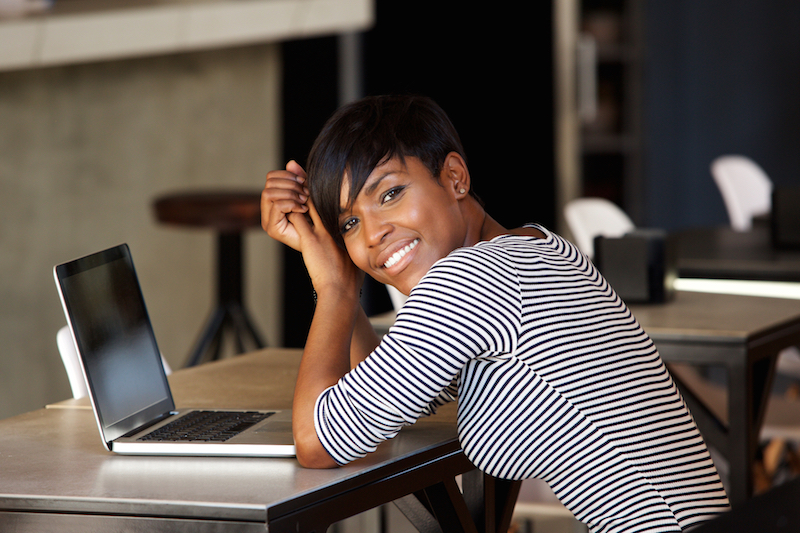 woman at laptop earning more money