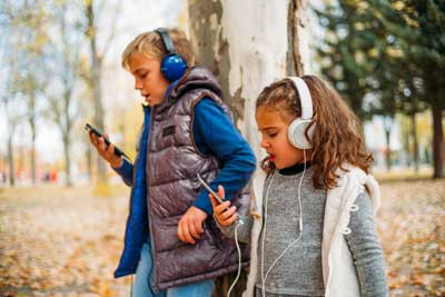 kids wearing headphones listening to music