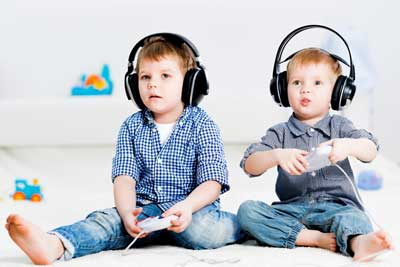 two boys playing with headphones on