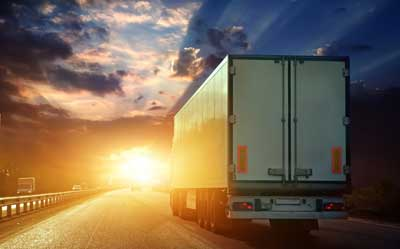 trucker heading into sunset