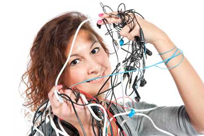 woman with tangled mess of eabuds
