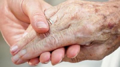 Elderly-senior-citizen-s-hand-held-by-younger-hand-jpg_20160209181503-159532