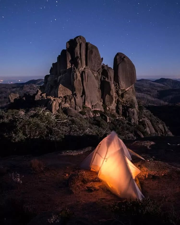 "Microadventures with @mitch_smith_ 1/5 ""Settling in for the night underneath the Cathedrals. This massive formation sits atop Victoria's Mt Buffalo. Granite Tors, rising above snow gums and wildflowers, complete the ultimate combination of a short hike and a rewarding view."" #weareexplorers"
