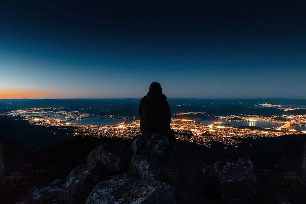 "Microadventures with @_davidsark 5/5 ""Freezing cold but it felt serene to watch the Hobart lights flicker on after sunset."" #weareexplorers"