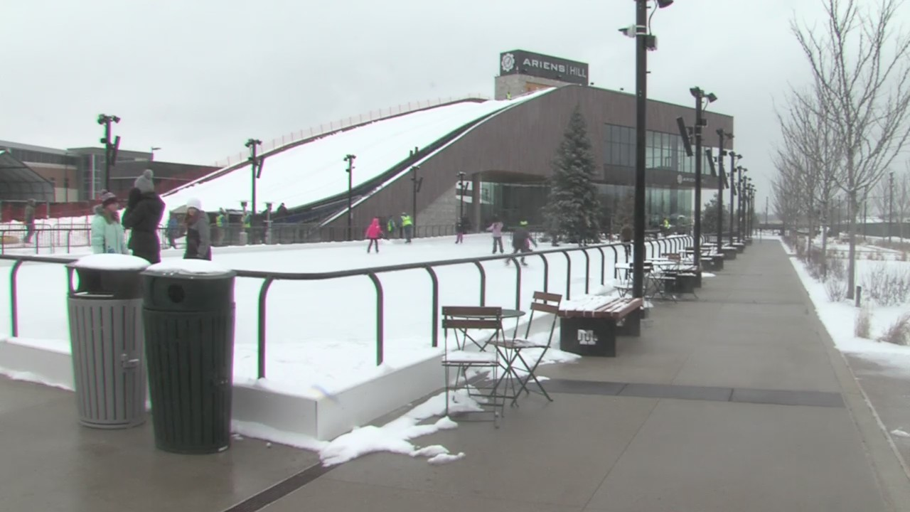 Families enjoy the fresh coat of snow