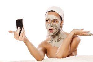 Woman with facemask taking a selfie