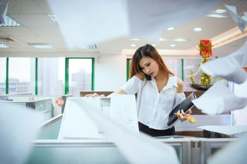 busy woman at photocopier