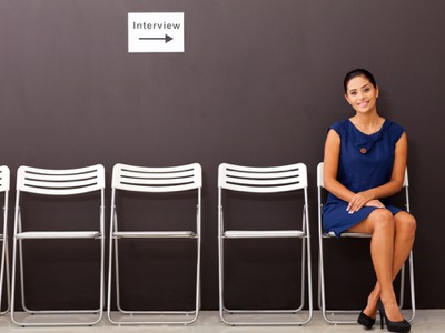 smartly-dressed-woman-waiting-for-interview-featured