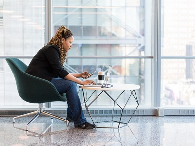 woman-using-a-laptop-in-the-office-featured