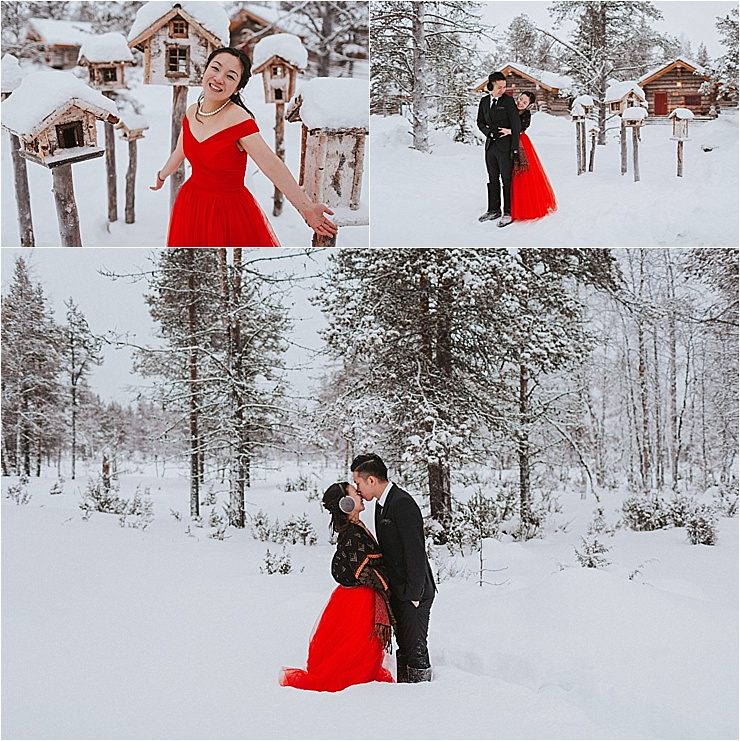 The bride wears a red dress in the snow for their wedding shoot in the forest in Finland by Maria Hedengren Photography