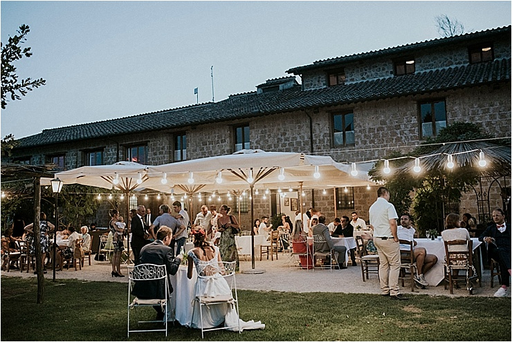 An outdoor wedding reception at Borgo di Tragliata by Michele Abriola