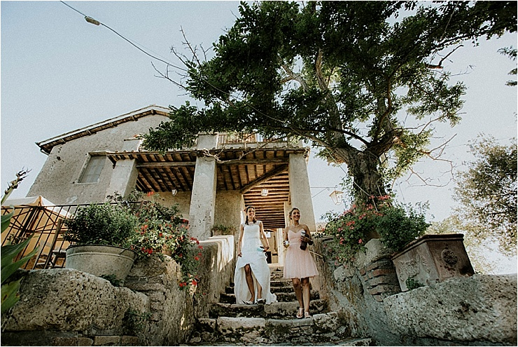 The bride leaves her room to walk to the wedding ceremony at Borgo di Tragliata by Michele Abriola