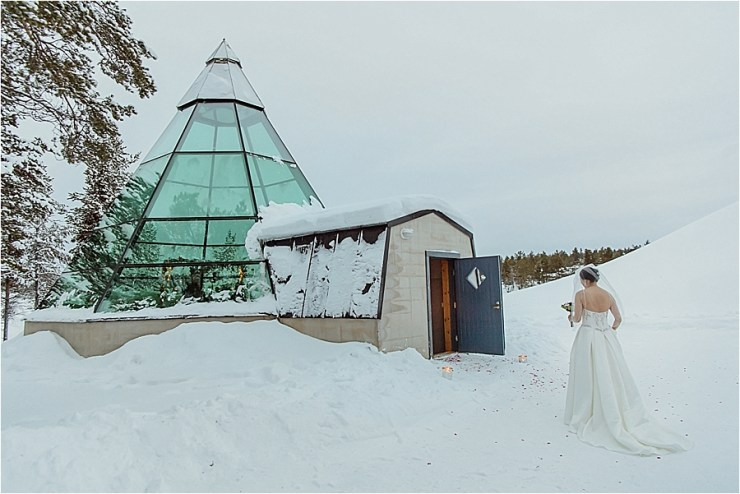 The bride arrives for her glass Kota wedding ceremony at Kakslauttanen arctic resort in Finland by Your Adventure Wedding
