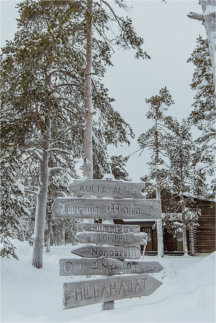A wooden sign at Kakslauttanen arctic resort in Finland by Your Adventure Wedding
