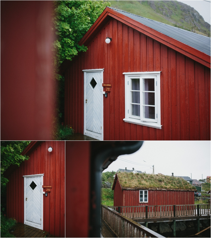 Red wooden cabins by the water in Lofoten Norway by Thomas Stewart