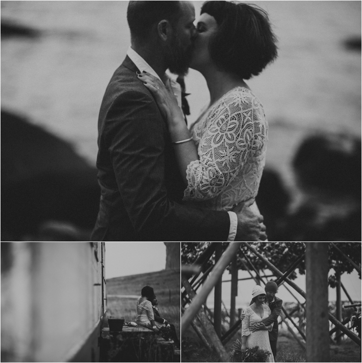 The bride and groom kiss by the ocean in Lofoten Norway by Thomas Stewart