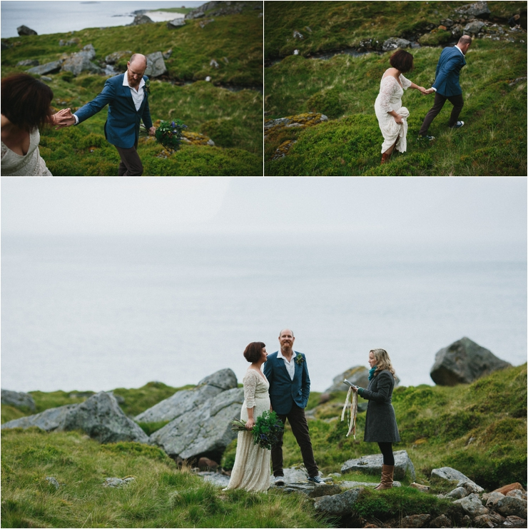 Maz and Dave arrive at their elopement ceremony location on a mountain top in Lofoten Norway by Thomas Stewart