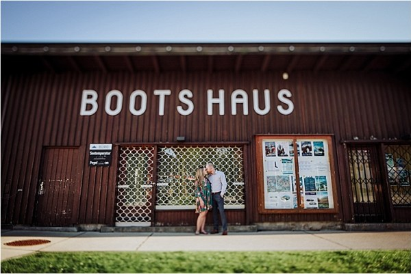 The boathouse or bootshaus at Lake Achensee in Austria, a great backdrop for an engagement photo by Wild Connections Photography