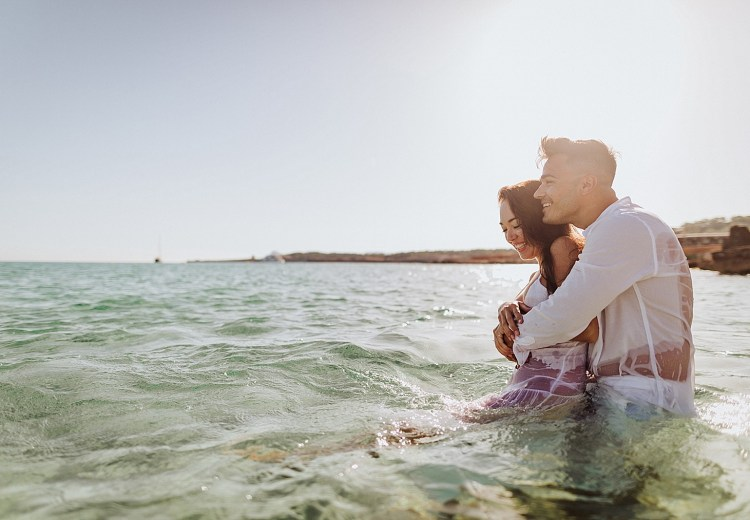 An engagement shoot in the ocean in Ibiza by Wild Connections Photography