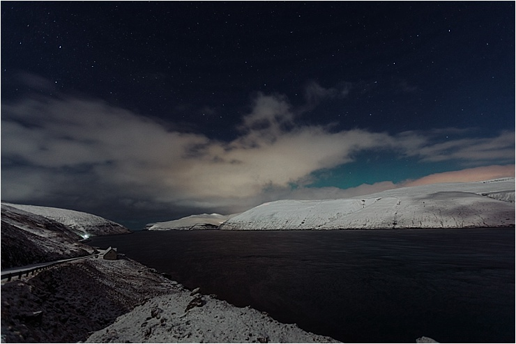 A faint glow or northern lights in the Faroe Islands in winter on We Are The Wanderers