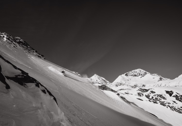 A skiier skiing off-piste on Stubai glacier by Ekkelboom-White Photography
