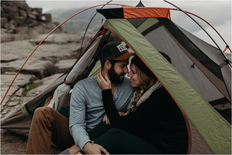 Couple looking at each other lovingly in a tent in Norway