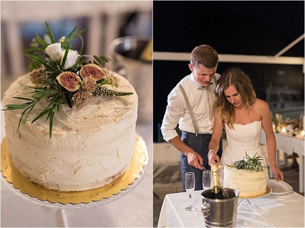 The bride and groom cut the cake in Loutro in Crete by Andreas Markakis Photography
