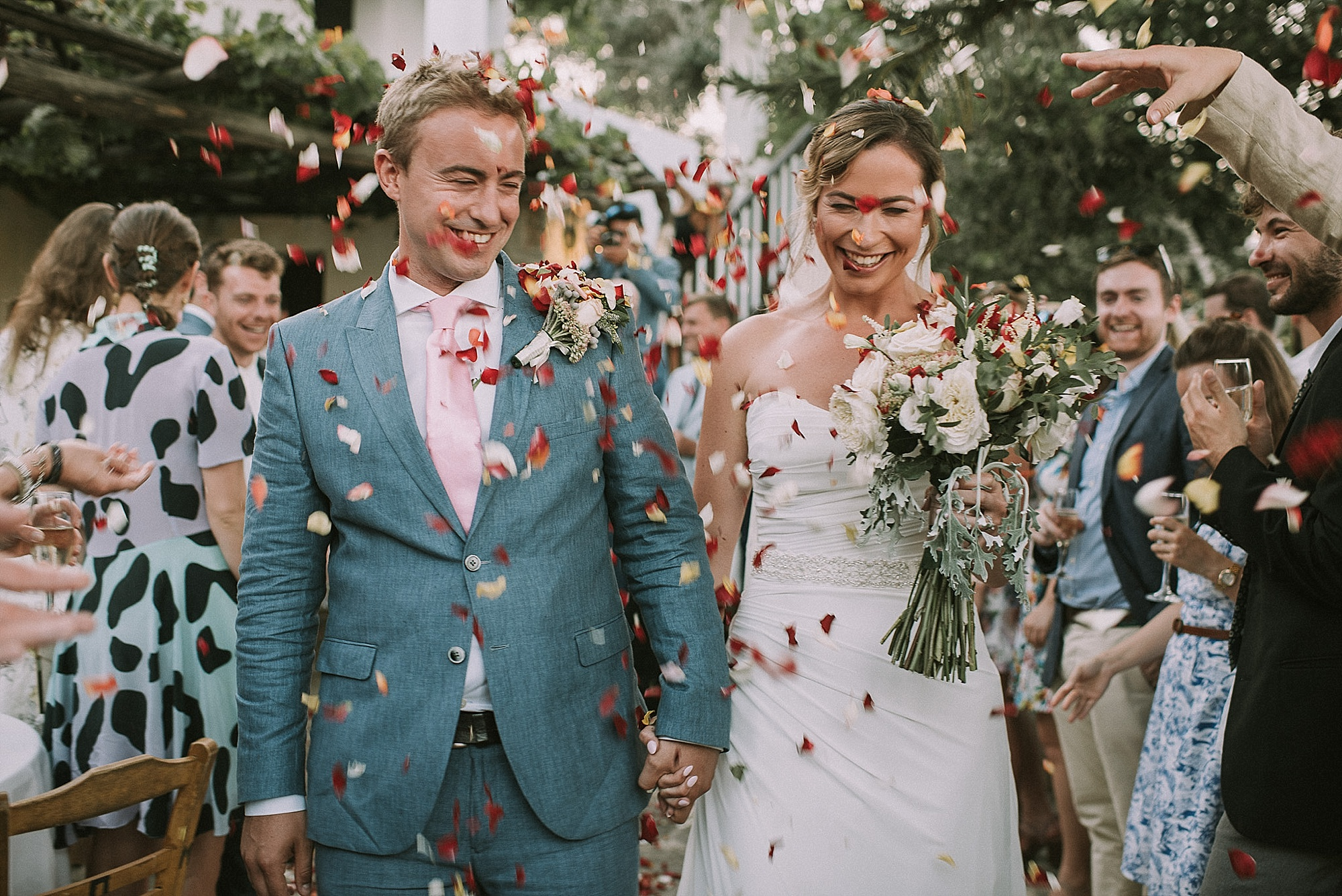Bride & groom are covered in confetti for their botanical park of crete wedding by Andreas Markakis Photography