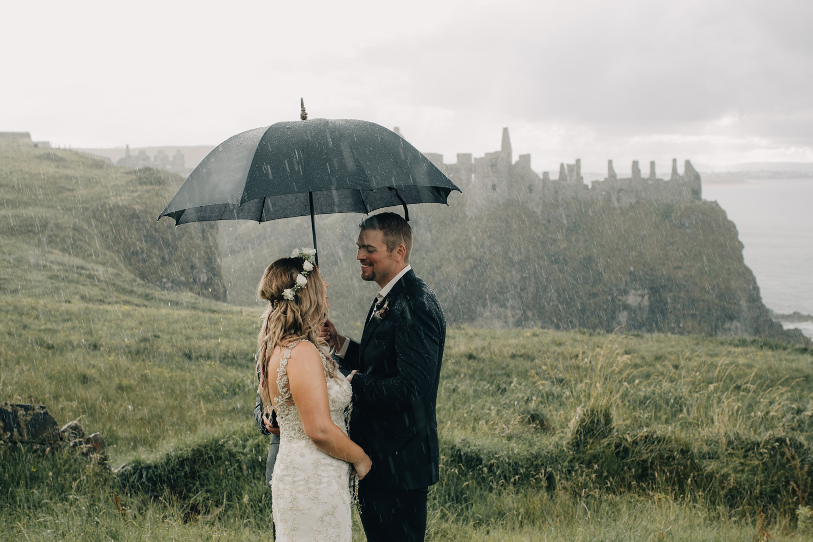 Dunluce Elopement bad weather on your wedding day by Paula O'Hara Photography