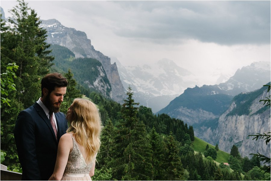 Bride and groom embrace with Lauterbrunnun in the background - After wedding honeymoon shoot in Wengen by Caroline Hancox Photography