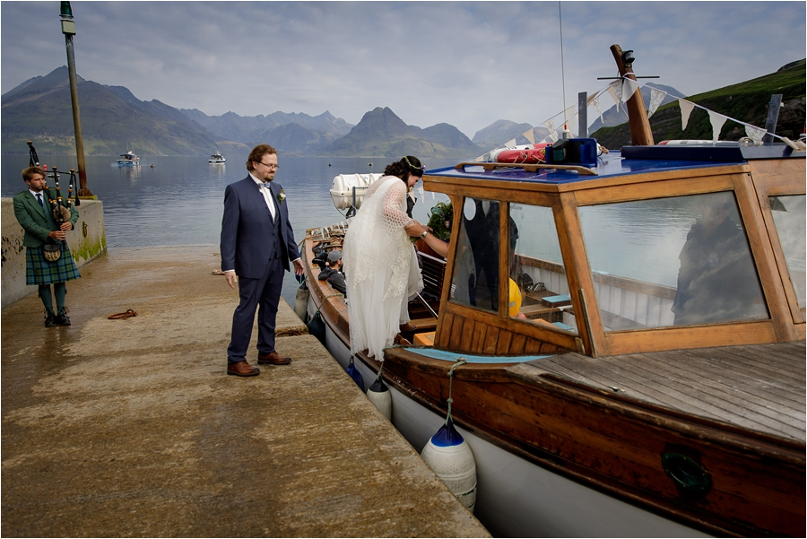 The bride and groom board the boat to their Loch Coruisk Elopement On The Isle Of Skye by Lynne Kennedy Photography