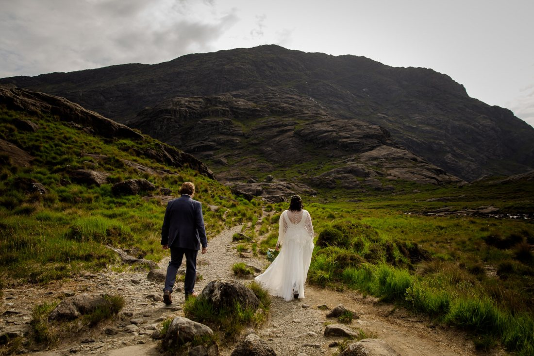 Tina & Jürgen walk to their elopement location by Lynne Kennedy Photography
