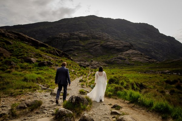 Tina & Jürgen walk to their elopement location by Lynne Kennedy Photography