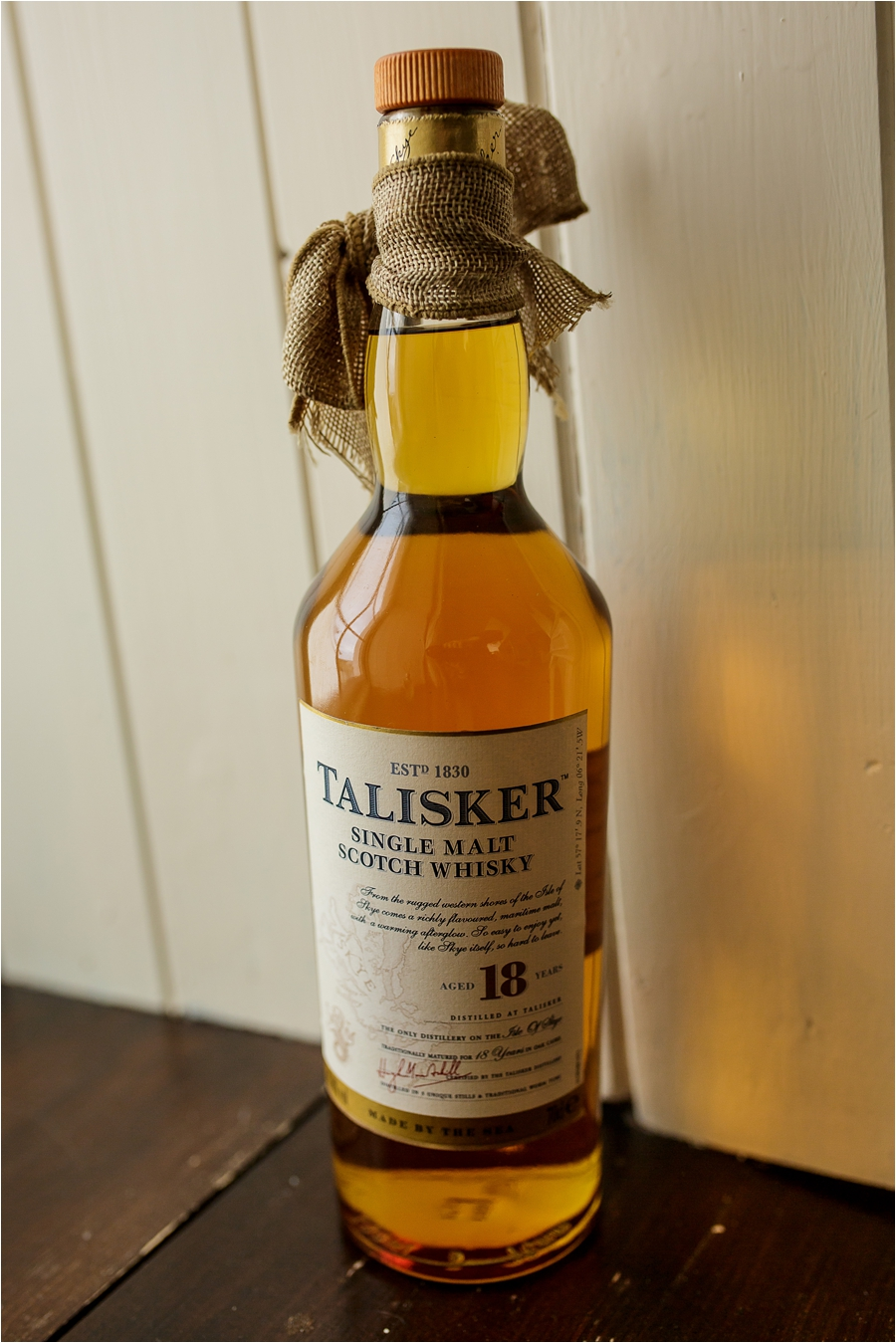 A bottle of Scotch whisky for a Loch Coruisk Elopement On The Isle Of Skye by Lynne Kennedy Photography
