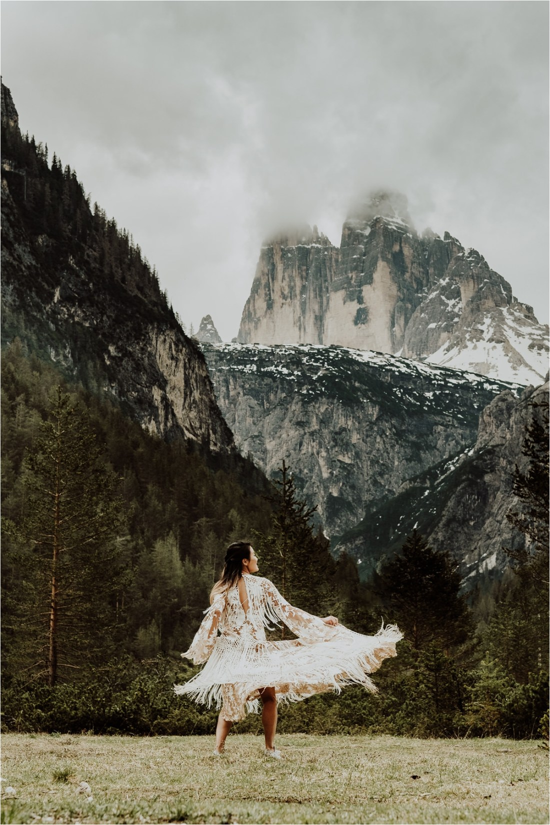 Christina twirls in her Rue De Seine wedding dress with the Tre Cime Three Peaks in the distance by Wild Connections Photography