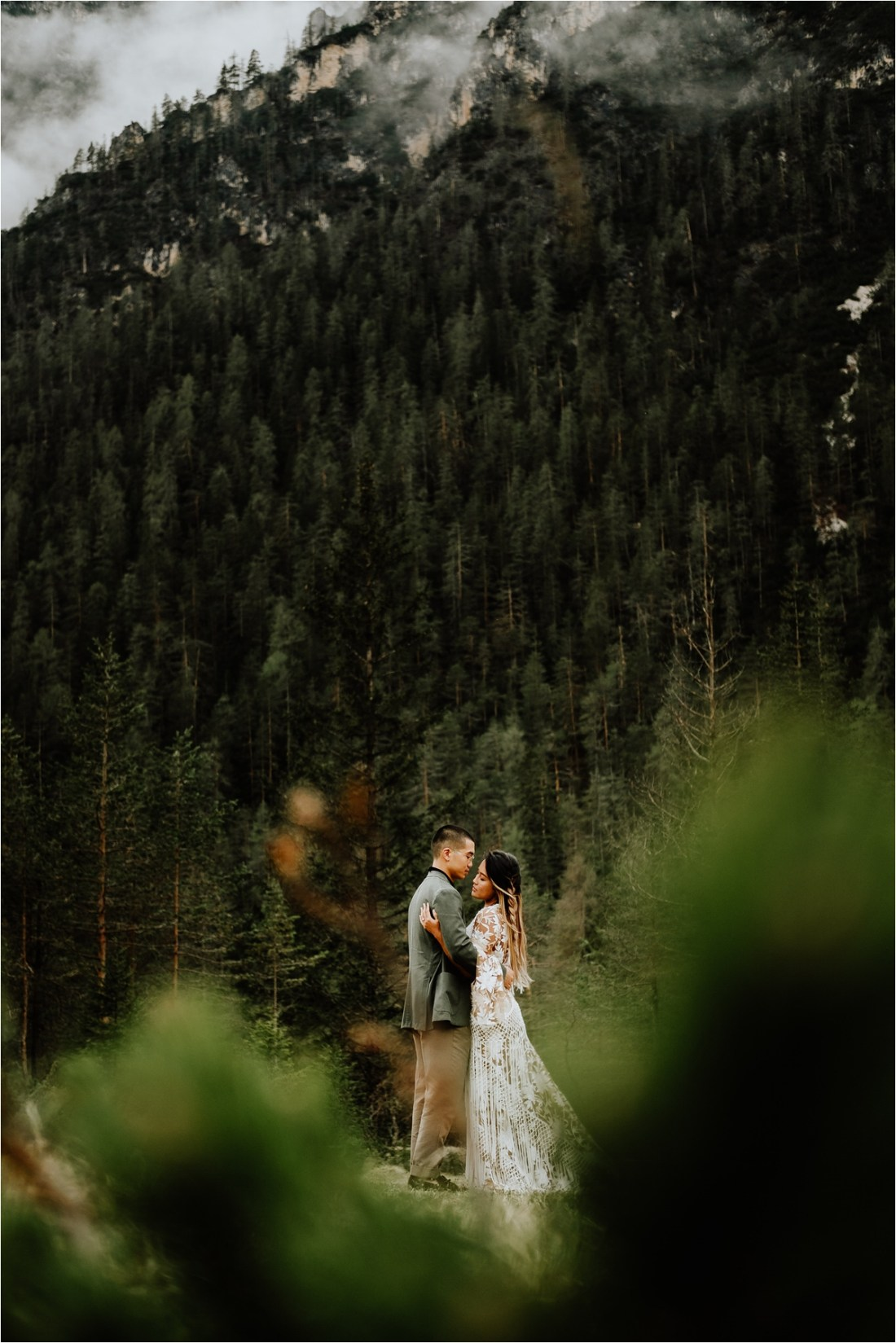 Christina & Ted embrace in the Dolomites for the pre-wedding photos by Wild Connections Photography