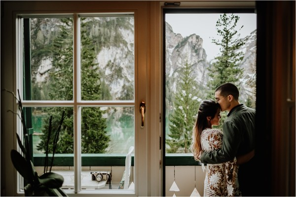 Christina & Ted on their hotel room balcony at Lago Di Braies by Wild Connections Photography