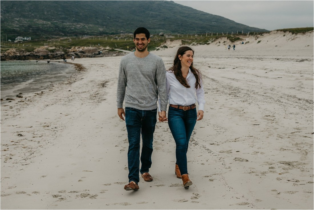 Katherine & Tommy take a stroll along the beach before their destination wedding in Ireland by No Other Love Photography