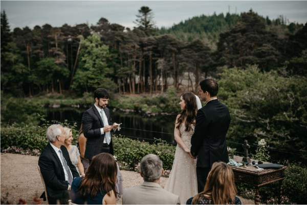 A family member does a reading at this intimate destination wedding ceremony in County Galway at Ballynahinch Castle by No Other Love Photography