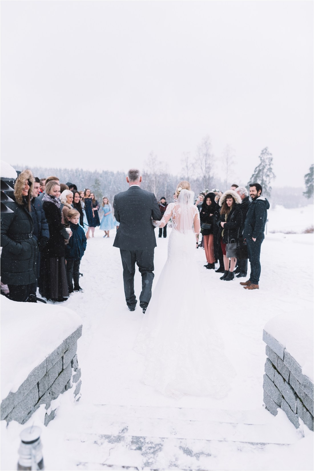 A winter wonderland wedding in Finland with an outdoor ceremony in the snow by Lucie Watson Photography