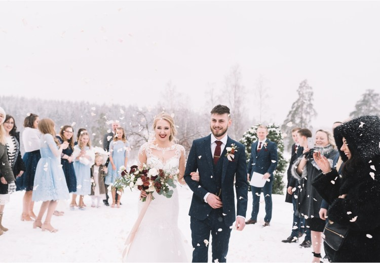 Winter wedding confetti like snow in Finland by Lucie Watson Photography
