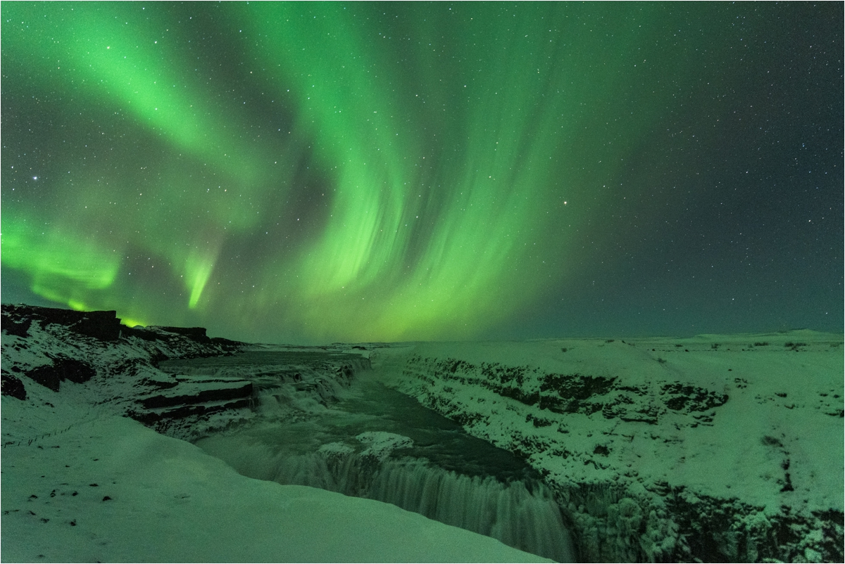 Northern lights over Gullfoss waterfall in Iceland by Rebecca Douglas Photography
