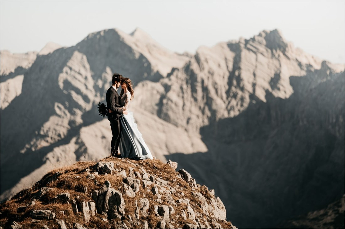 Bride and groom stand on a mountain in the Bavarian Mountains by Aneta Lehotska