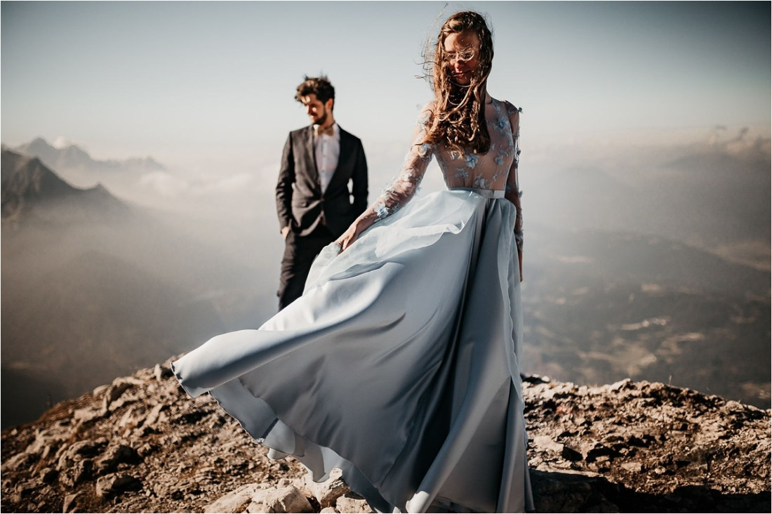 The bride waves her blue dress in the wind by Aneta Lehotska
