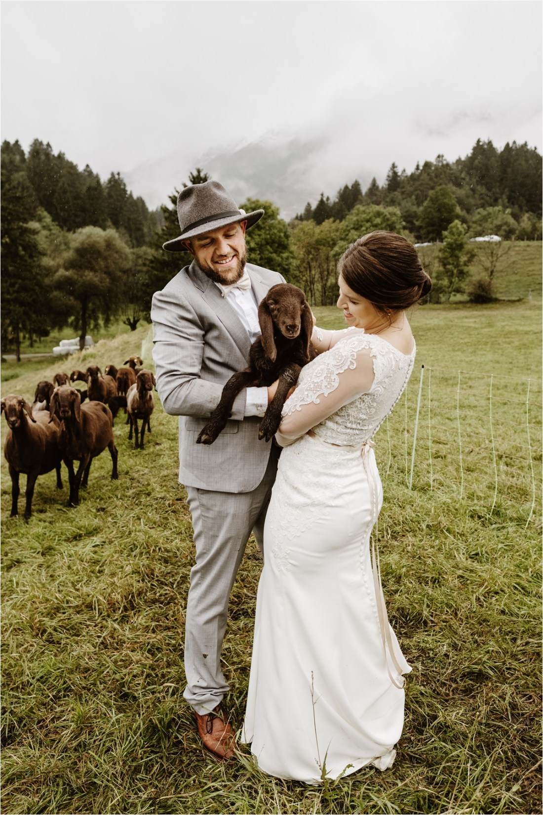 Bride and groom hold a baby lamb after their Innsbruck Elopement. Photos by Wild Connections Photography