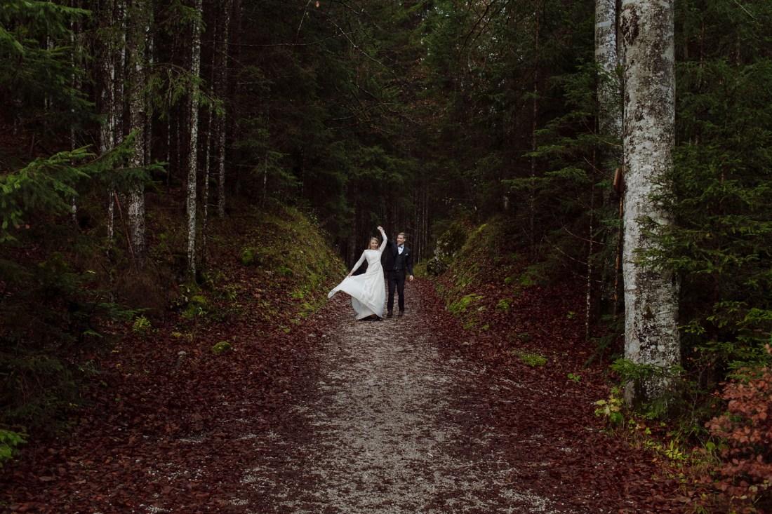 Bride and groom dancing in the woods