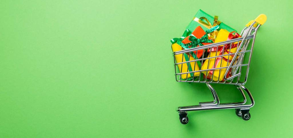 Shopping trolley filled with Christmas presents