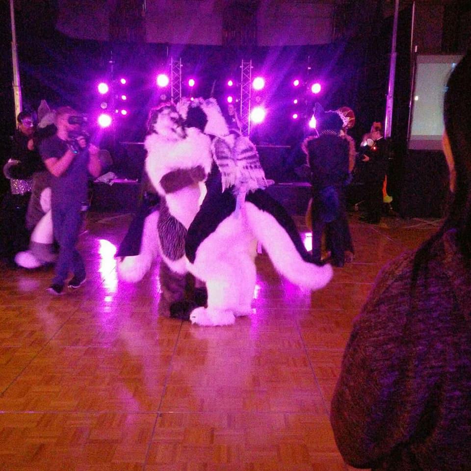 Engaged at a ballroom masquerade
