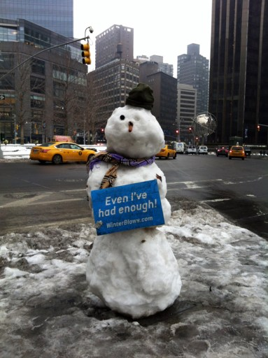 A Winter weary snowman in Columbus Circle, NYC.  Photo Credit: The Weather Gamut